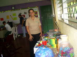 Directora Nolvia Morales with donated supplies