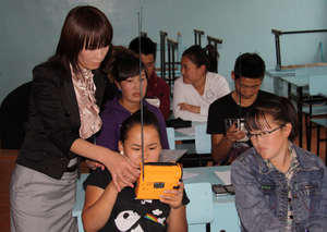 Teacher and students working with new radios