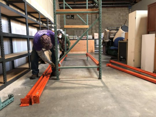 Building new shelves at the warehouse