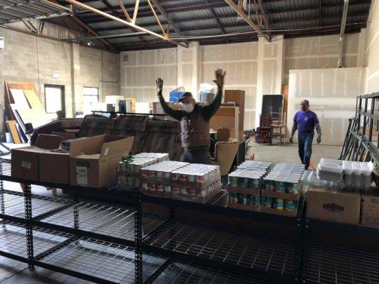 Warehouse manager Dan Joseph at new food tables