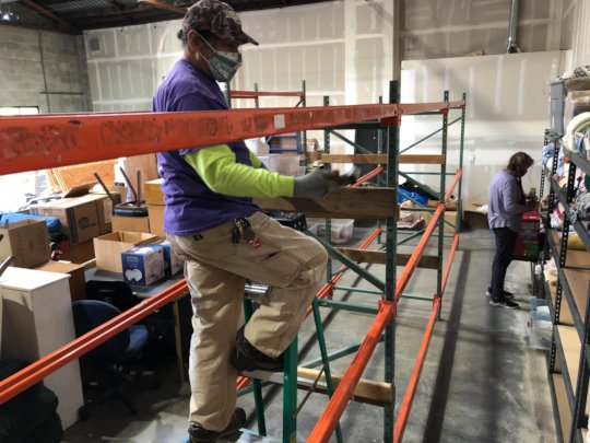 Putting in wall units at the new warehouse