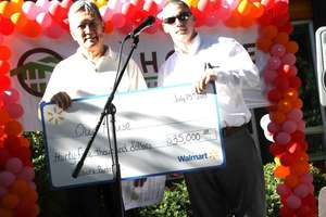 Walmart presents a check for our food programs