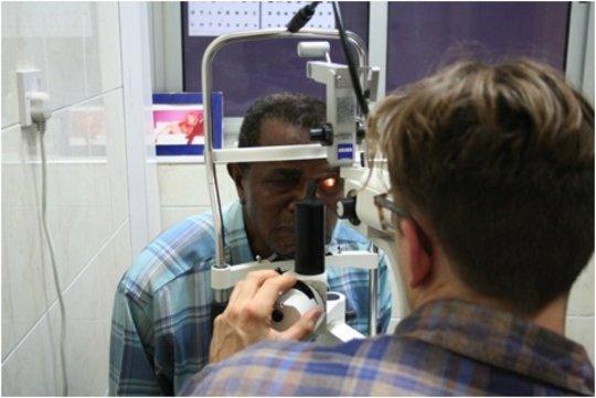 Dr. Bujak examines cornea patient