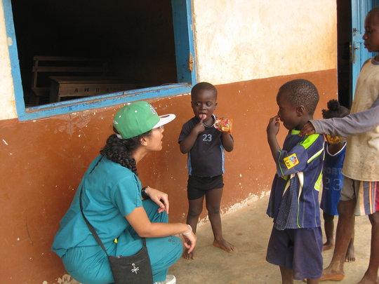 Dr. Zahra speaking with children