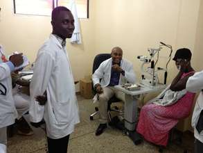 Dr. Peter Armah examining a patient