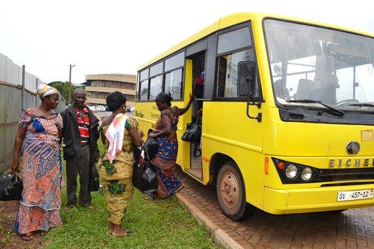 Patients arrive by bus for treatment.