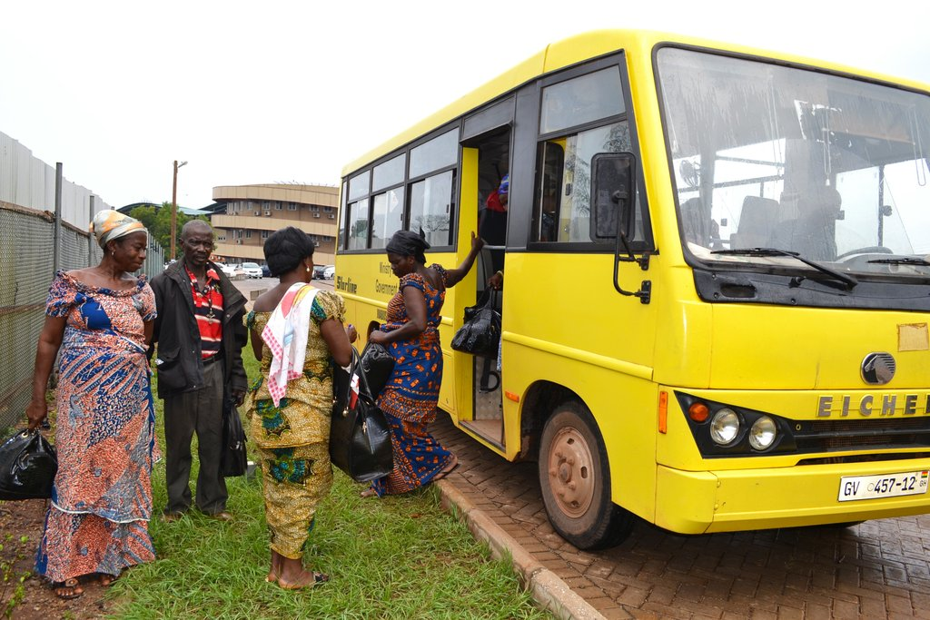 Patients arrive by bus for treatment.