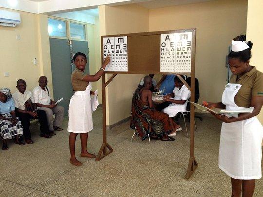 Nursing students conducting eye screenings
