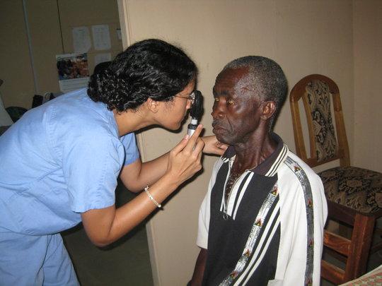 Dr. Zahra examining a patient.