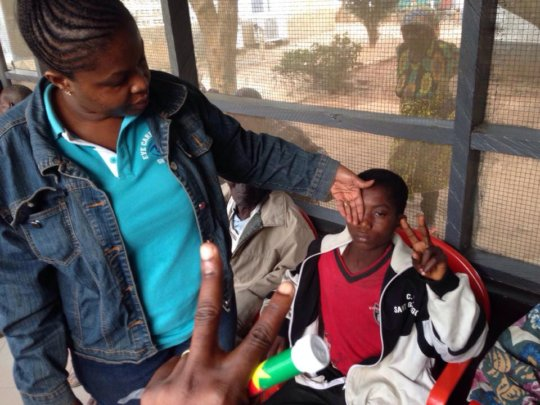 Dr. Frimpong examines patient