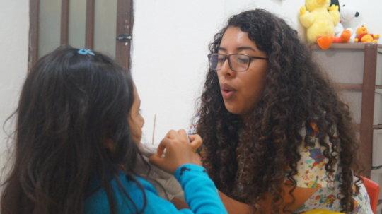 Maricruz in a speech therapy session