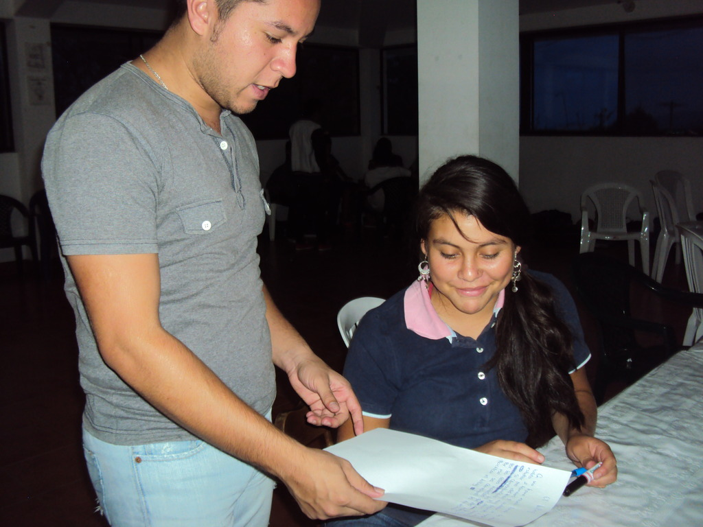 Henry helps a student in the leadership program.