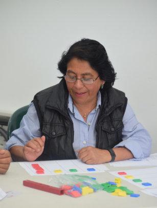 Teachers working with math manipulatives