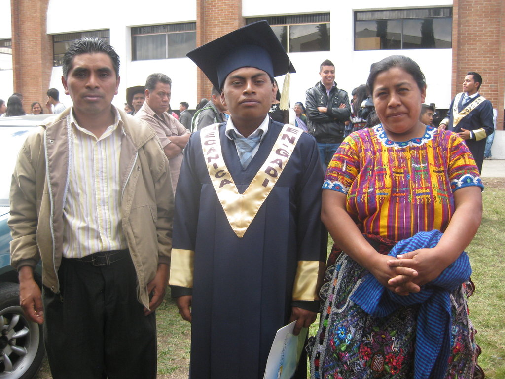 Luis with his parents at graduation