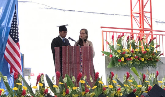 Andres speaking at the graduation ceremony