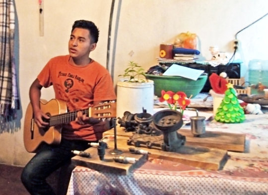 Marco playing his guitar