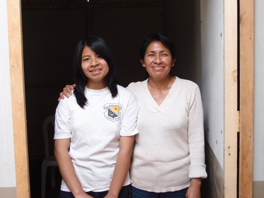 Teresa and her daughter in their new home