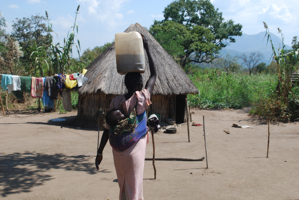 Carrying 20 liter jerry - can water & a baby