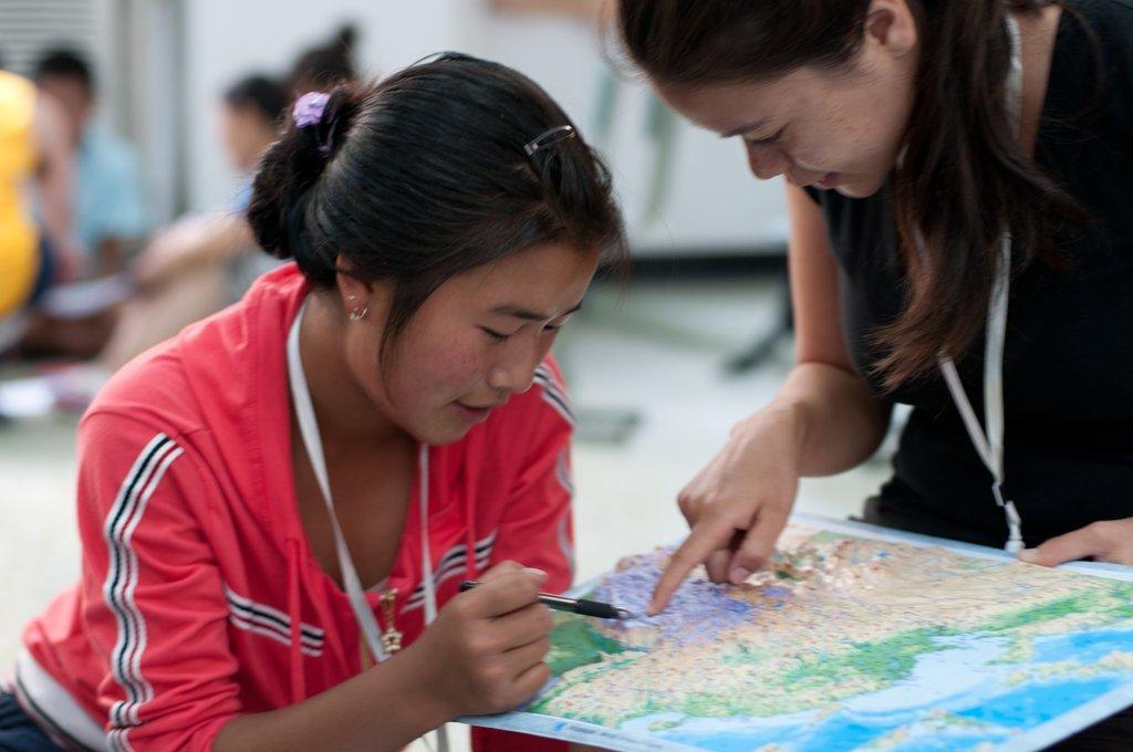 Tibetan student with volunteer