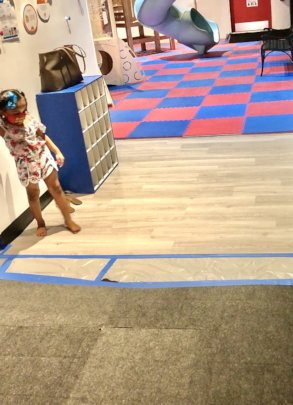 A child enjoys a small section of new flooring