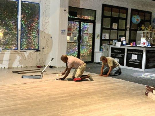 Volunteers Help Install Vinyl Plank Flooring