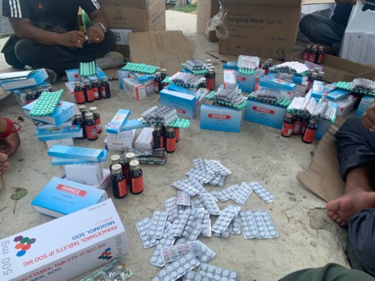 Packing medicine to handover the needy people