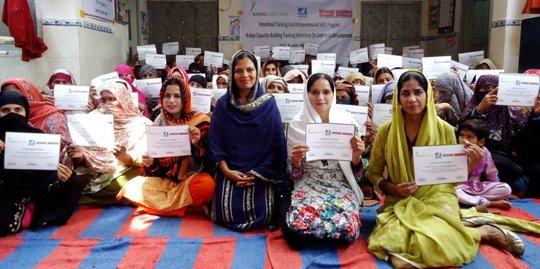 Entrepreneurs proudly displaying graduation certs