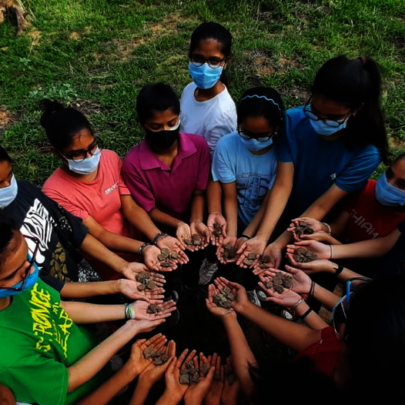 Children planting seeds for the environment