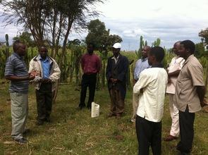 Kelvin with Peter, planting the Philemon trees