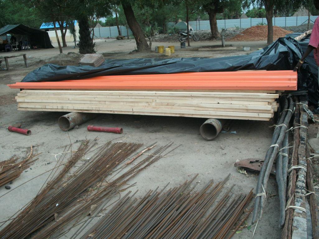 Iron sheets, timber beams, wire mesh