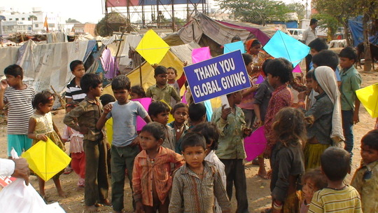 Children excited to receive kites