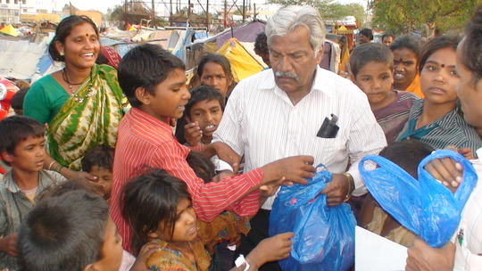 child receiving his stationery kit