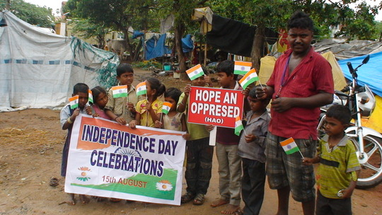 children happy to receive national flags