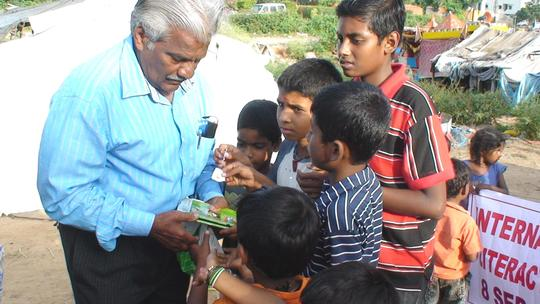 Children receiving literacy material