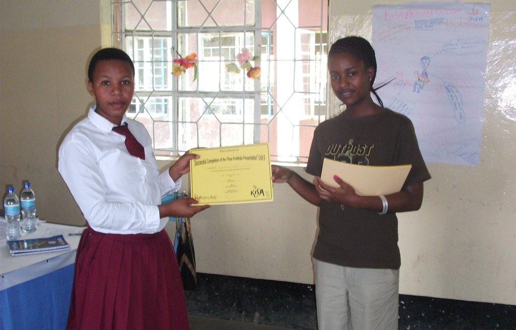 Eliakunda Receiving Her Kisa Certificate