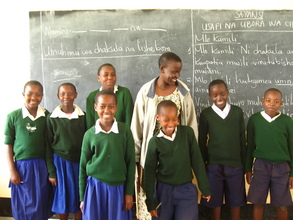 Teacher-in-training, Prisca, with her students