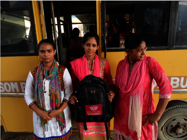 Lokesh (middle) on the Blossom Bus to College