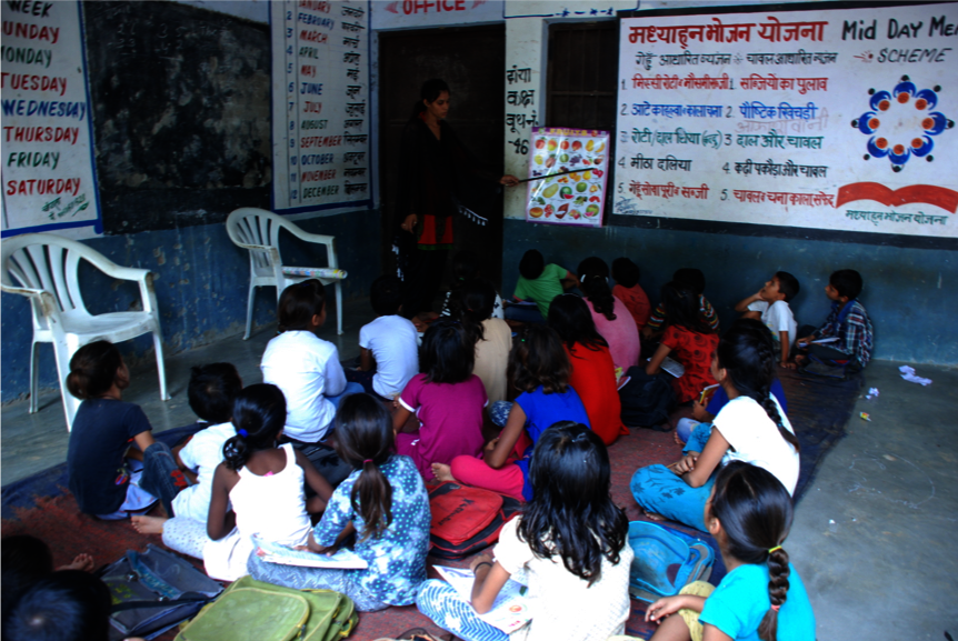 Lokesh teaching EQ+ Program children