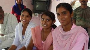 Sarita, Devi and Sangeeta + families in background