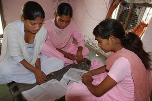 Sarita, Devi and Sangeeta studying