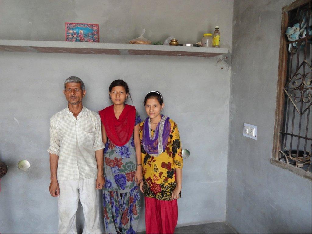 Madhu & Manju (far right) pose with their father