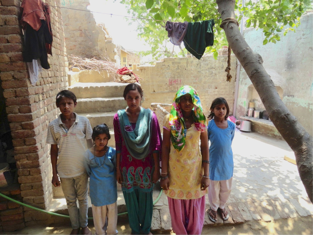 Manju (center, blue scarf) with her mom & siblings