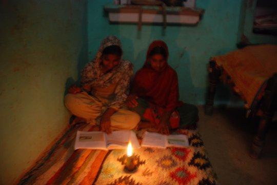 Mausmin and friend studying by kerosene lamplight