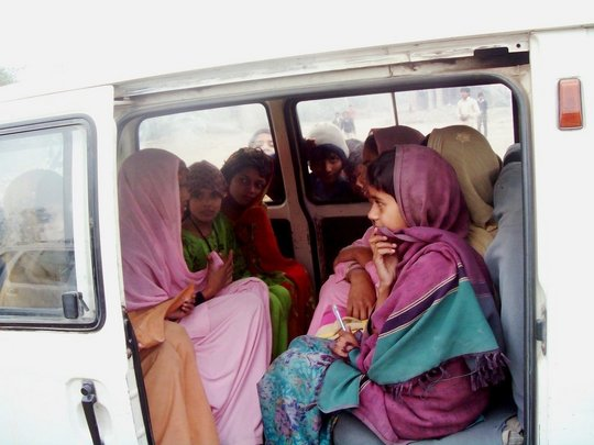 Girls taking a mini-bus to school