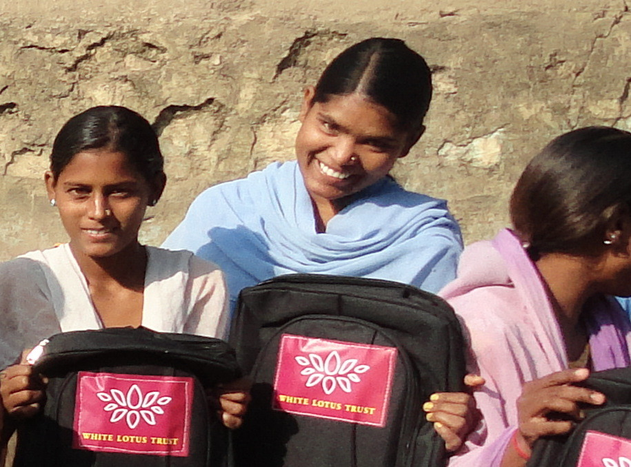 Pooja (center) is back in school thanks to you!