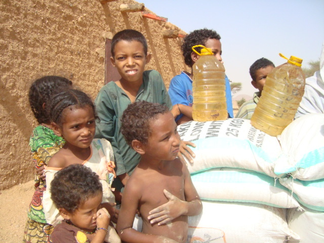 Children in Tadek with Food Aid