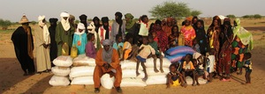 Teyiss community poses with food distribution.