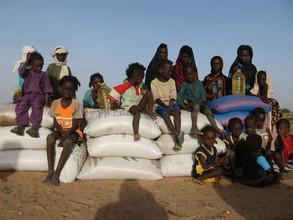 Children receive food aid in Teyiss.