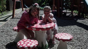 Adeline and Her Sister at the Toadstool Tea Table