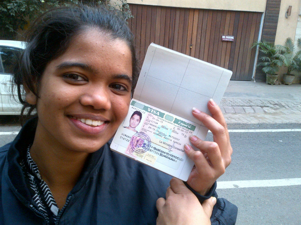 Kavita with her passport and Morocco visa